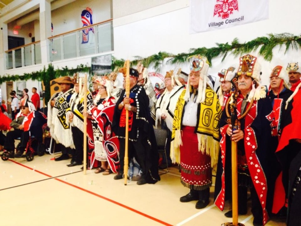 Heiltsuk Hemas standing with Haida Hereditary Chiefs