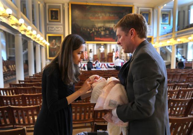 Asa Valenti from Iran and her husband Paul checked on their 6-day old baby Amelia after the ceremony.