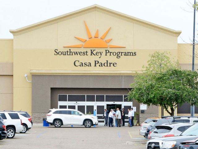 FILE - In this June 18, 2018 file photo, dignitaries take a tour of Southwest Key Programs Casa Padre, a U.S. immigration facility in Brownsville, Texas, where children who have been separated from their families are detained. The American Civil Libe