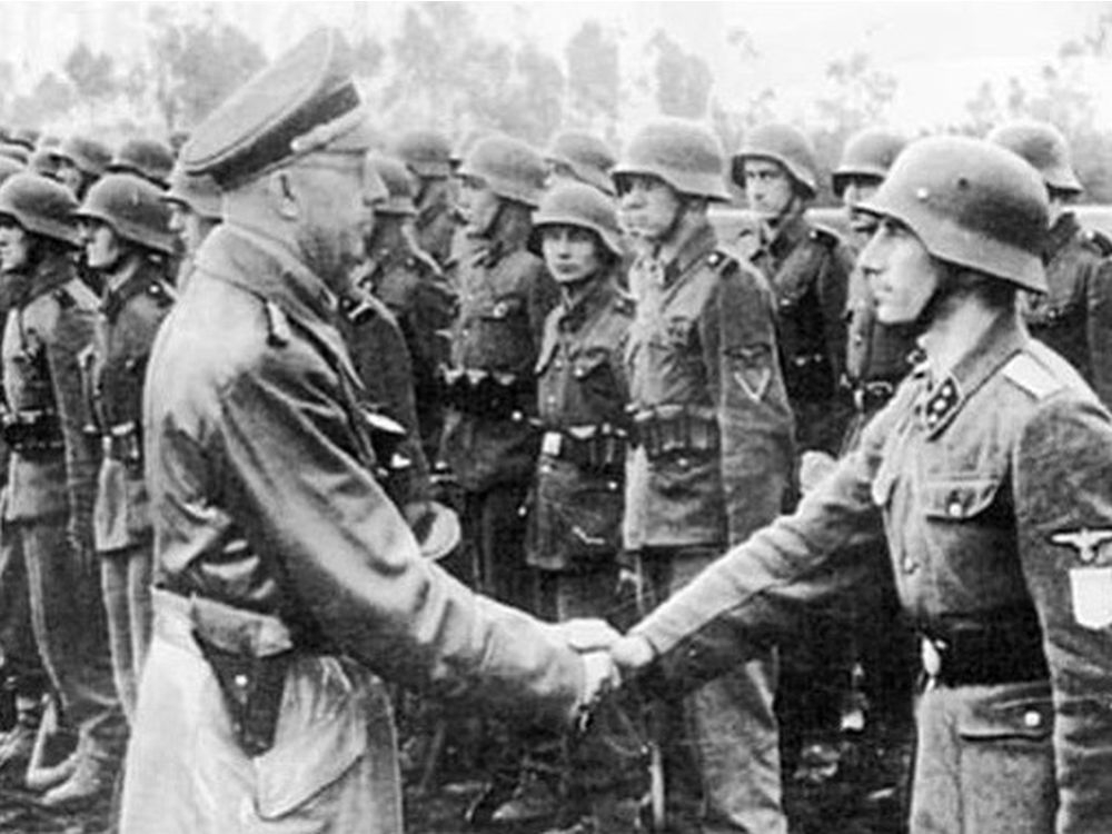 SS leader Heinrich Himmler greets members of the 14th SS Division during the Second World War. Police say graffiti left on an Oakville monument to the SS division is being investigated as a hate-motivated crime. (Photo courtesy US Holocaust Memorial Museum)