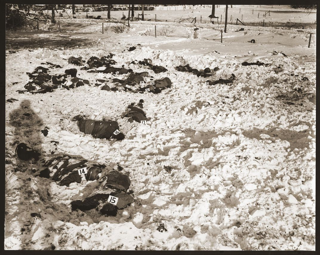 The remains of American prisoners of war murdered in December 1944 near the Belgian city of Malmedy. The bodies were identified by number for use in war crimes trials brought against more than 70 Nazi soldiers by the U.S. military.